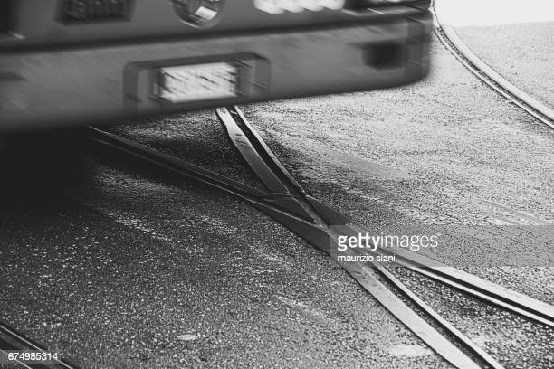 trams on railroad tracks in city - bianco e nero stock pictures, royalty-free photos & images
