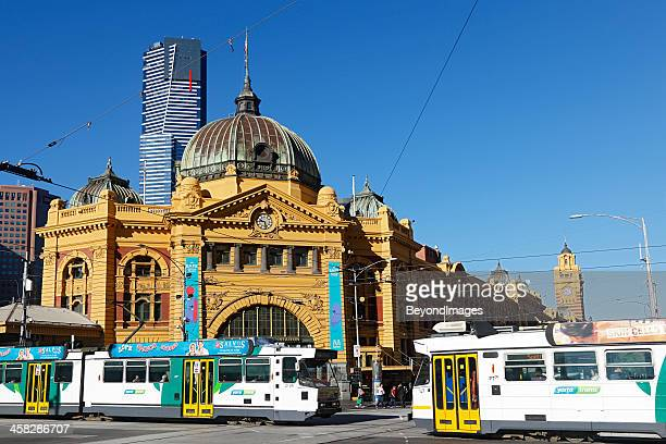 Trams pass in front of Flinders Street Station, Melbourne