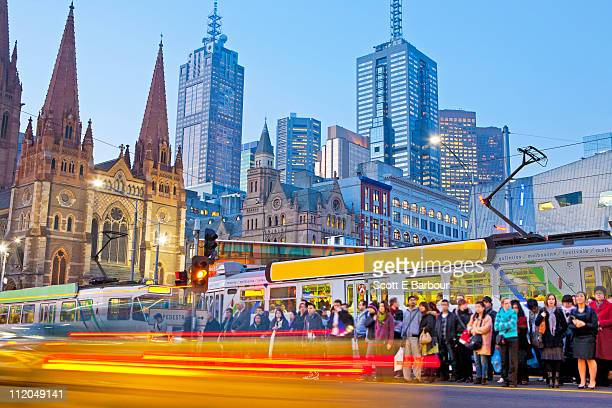 Trams, people and Melbourne city skyline