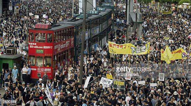 Trams sit stranded as thousands of people block the streets in a huge protest march against a controversial anti-subversion law known as Article 23...