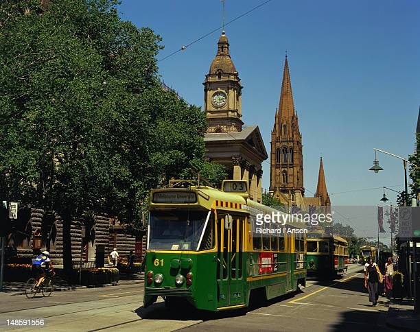 Trams trundle along Swanston Street in the city centre.