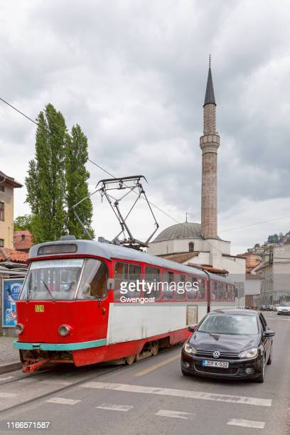 tramway passing by the muslihudin čekrekčija mosque in sarajevo - gwengoat stock pictures, royalty-free photos & images