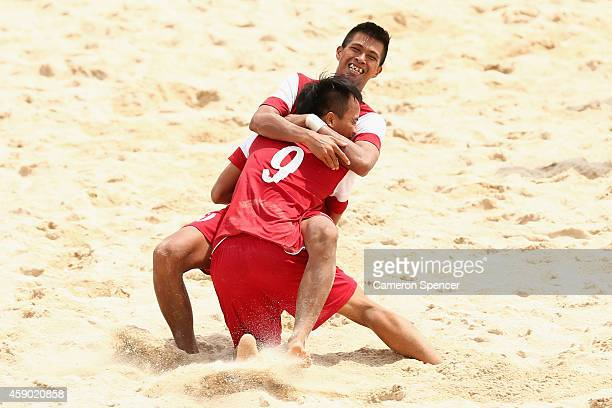 Tran Tuan Anh Bui of Vietnam congratulates team mate Vinh Phong Tran after scoring a goal during the Beach Soccer match between Kuwait and Vietnam...