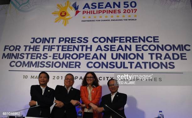 Tran Tuan Anh Vietnam's minister of Trade and Industry Ramon Lopez Philipine Secretary for Trade and Industry and chairman of ASEAN economic...