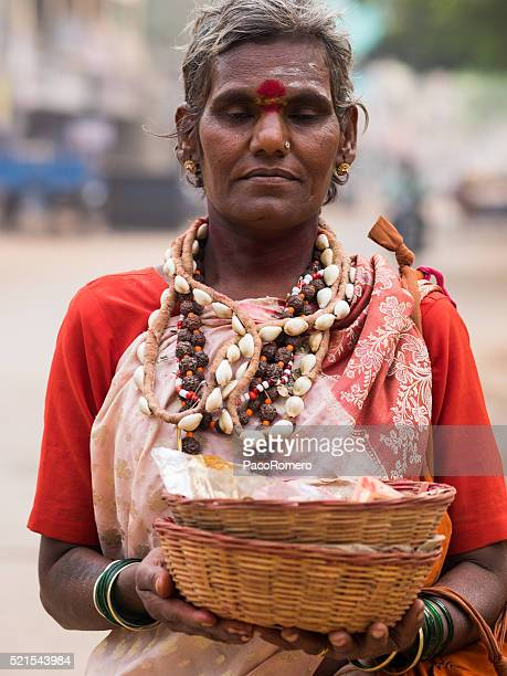 Trangender man offering blessings in Hospet, Southern India