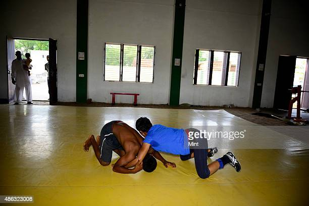 Traniee wrestlers during the training session at Balali akhara features both boys and girls in Balali Village on August 21, 2014 in Bhiwani, India....