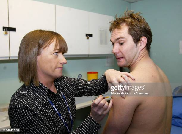 Tranmere Rovers captain Jason McAteer is given an MMR jab by nurse Barbara Robinson An entire squad of professional footballers was given the MMR...