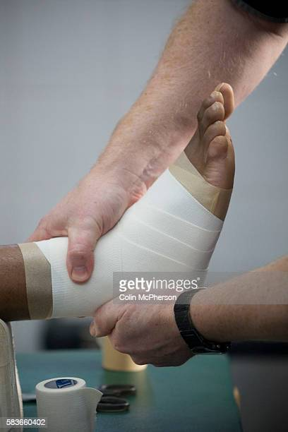 Tranmere Rovers' club physio Les Parry in the club's treatment room applying strapping to a player's ankle prior to a training session Les Parry has...