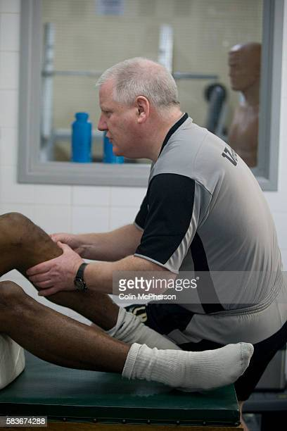Tranmere Rovers' club physio Les Parry in the club's treatment room assessing the damage to captain Ian Goodison's knee which had been injured two...