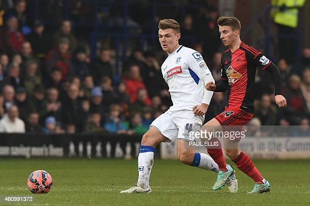 Tranmere Rovers' English midfielder Max Power vies with Swansea City's English midfielder Tom Carroll during the English FA Cup third round football...