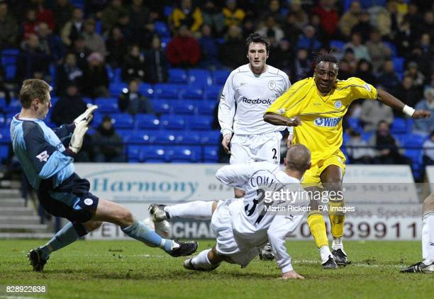Tranmere Rovers' Eugene Dadi scores past Bolton Wanderer's keeper Kevin Poole during their FA Cup third round replay match at the Reebok Stadium...