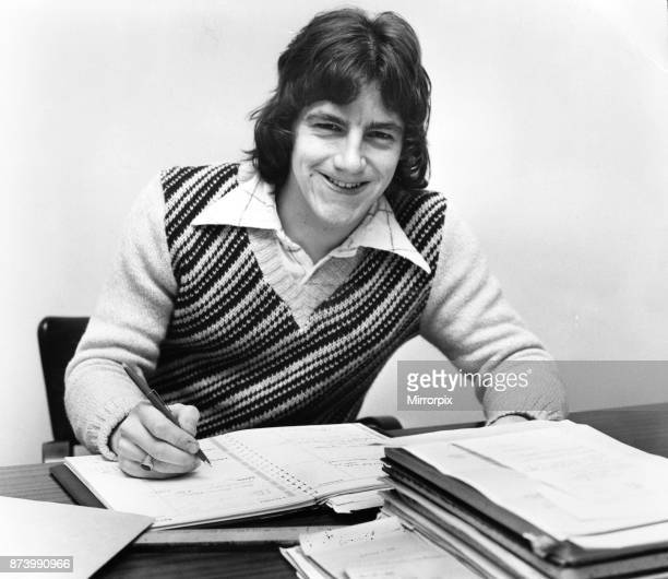 Tranmere Rovers footballer Steve Coppell sitting at his desk as he studies for his degree December 1974