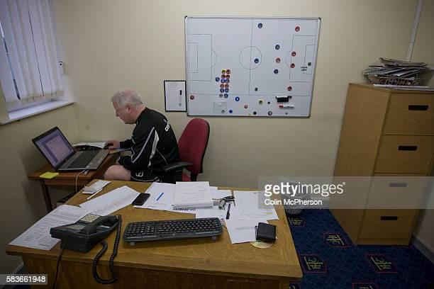 Tranmere Rovers manager Les Parry in his office preparing a powerpoint presentation for a player briefing at the club's Prenton Park ground the day...