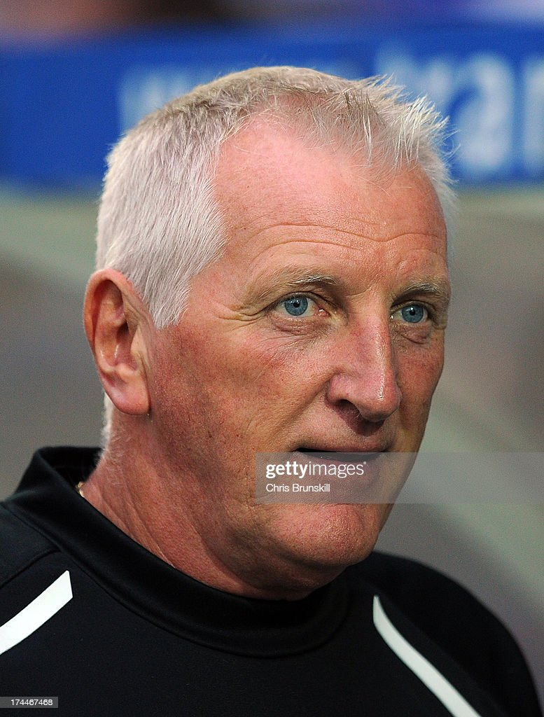 Tranmere Rovers manager Ronnie Moore looks on during the pre season friendly match between Tranmere Rovers and Burnley at Prenton Park on July 23, 2013 in Birkenhead, England.