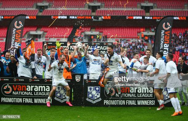 Tranmere Rovers players celebrate victory with the trophy after during the Vanarama National League Play Off Final between Boreham Wood and Tranmere...