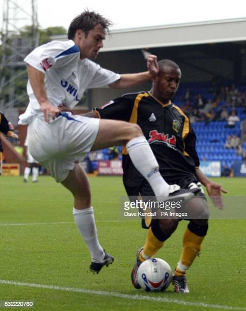 Tranmere's Robbie Stockdale shoots past Yeovil's Ishmael Welsh during the CocaCola League One match at Prenton Park Wirral
