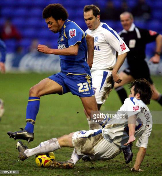 Tranmere's Robbie Stockdale takes the ball away from Doncaster's Jason Price with a sliding tackle during the League One match at Prenton Park...