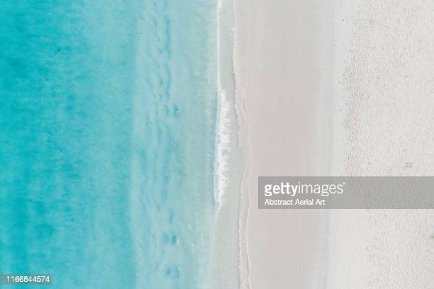 tranquil aerial shot of the ocean and a beach, barbados - water's edge stock pictures, royalty-free photos & images