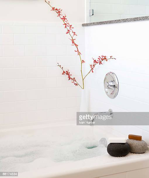 Tranquil bathtub with soaps and flowers