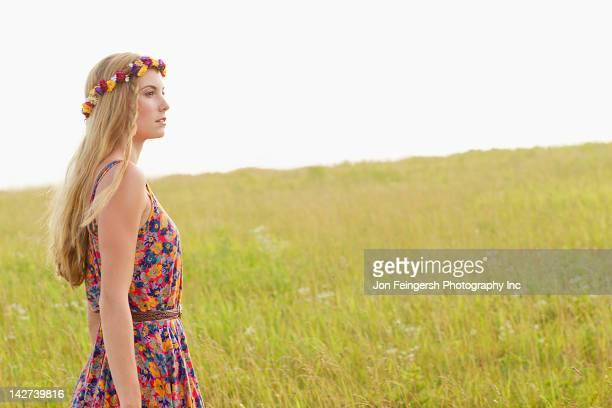 Tranquil Caucasian woman walking in field
