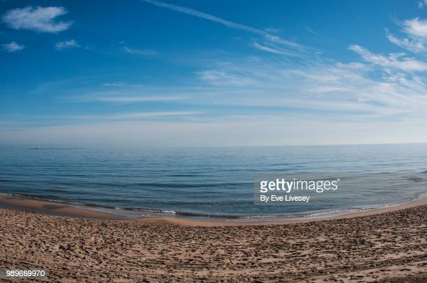tranquil day in villajoyosa - wispy stock photos and pictures