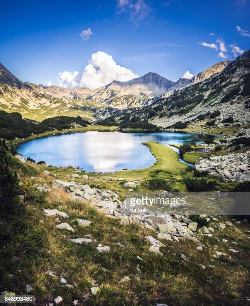 tranquil lake in the mountains - bansko stock pictures, royalty-free photos & images