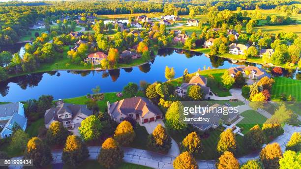 Tranquil lakeside neighborhood in Autumn Splendor at Sunrise, aerial view.