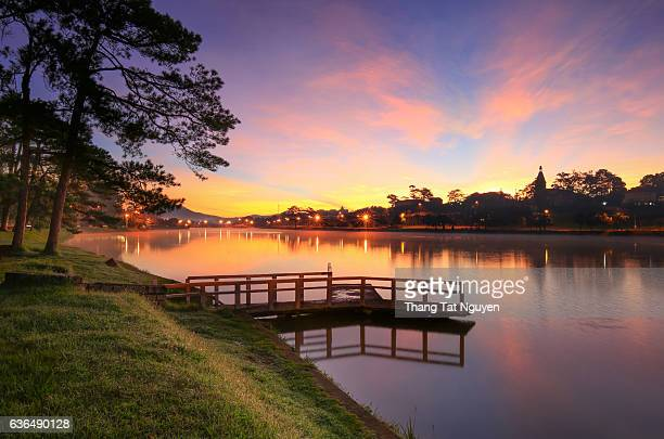 Tranquil landscape of Dalat city, a part of Ho Xuan Huong lake in Dalat at dawn