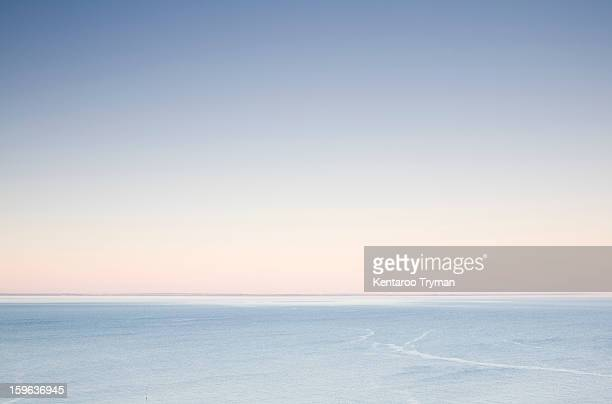 tranquil ocean water at dawn - morning ストックフォトと画像