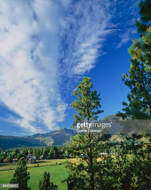tranquil, rural scene near mountains. - leavenworth washington stock photos and pictures