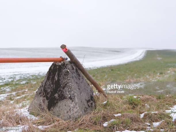 Tranquil rural scene, winter field, boom barrier