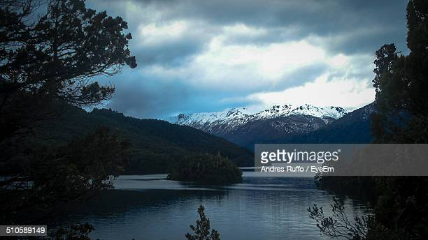 tranquil scene of mountains and lake against dramatic sky - andres ruffo stock pictures, royalty-free photos & images