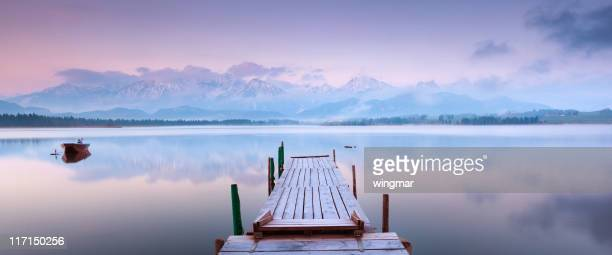 tranquil scene with boat at lake hopfensee - jetty stock pictures, royalty-free photos & images