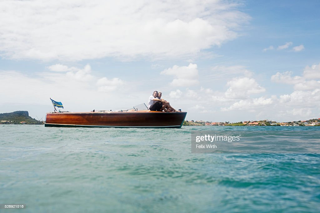 Tranquil scene with couple on boat : Stock Photo