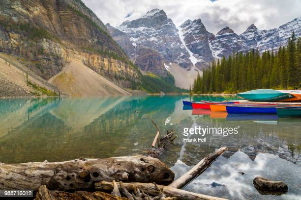 tranquil setting of rowing boats on moraine lake, banff national park, unesco world heritage site, canadian rockies, alberta, canada, north america - unesco stock-fotos und bilder