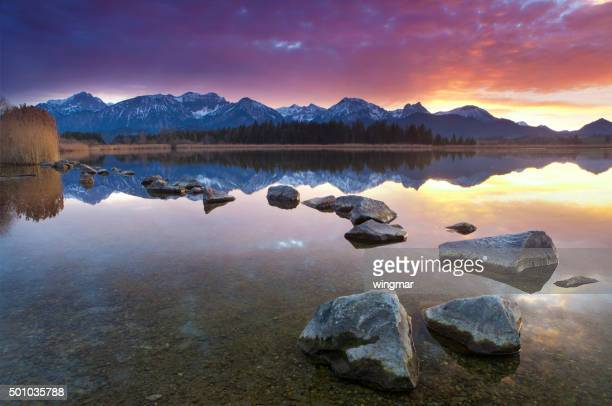 tranquil sunset at lake hopfensee, bavaria, allgaeu, germany