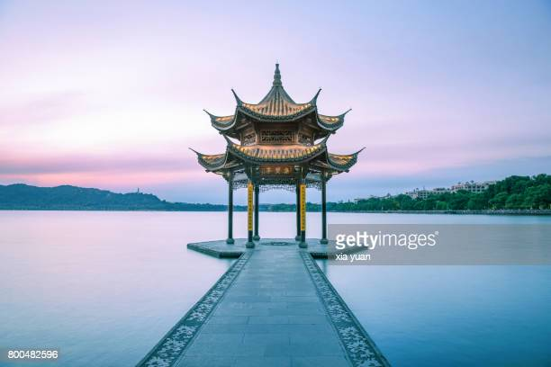 tranquil sunset over the pavilion on the west lake,hangzhou,china - east asia stock pictures, royalty-free photos & images