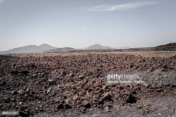 tranquil view of arid landscape against sky - albrecht schlotter stock pictures, royalty-free photos & images