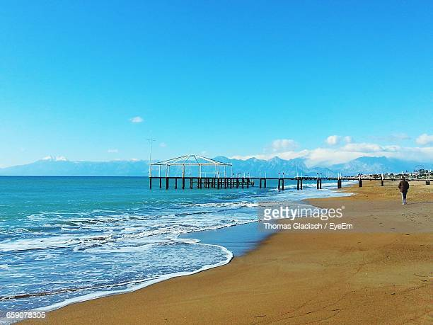 tranquil view of beach against sky - belek stock pictures, royalty-free photos & images