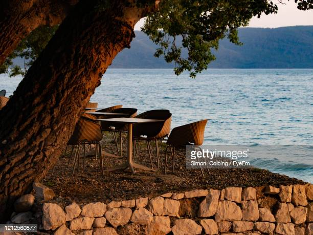 tranquil view of dining table against sea - colbing stock pictures, royalty-free photos & images