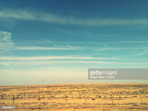 Tranquil view of landscape against sly