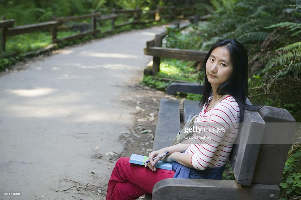 Tranquil Woman On A Park Bench High-Res Stock Photo