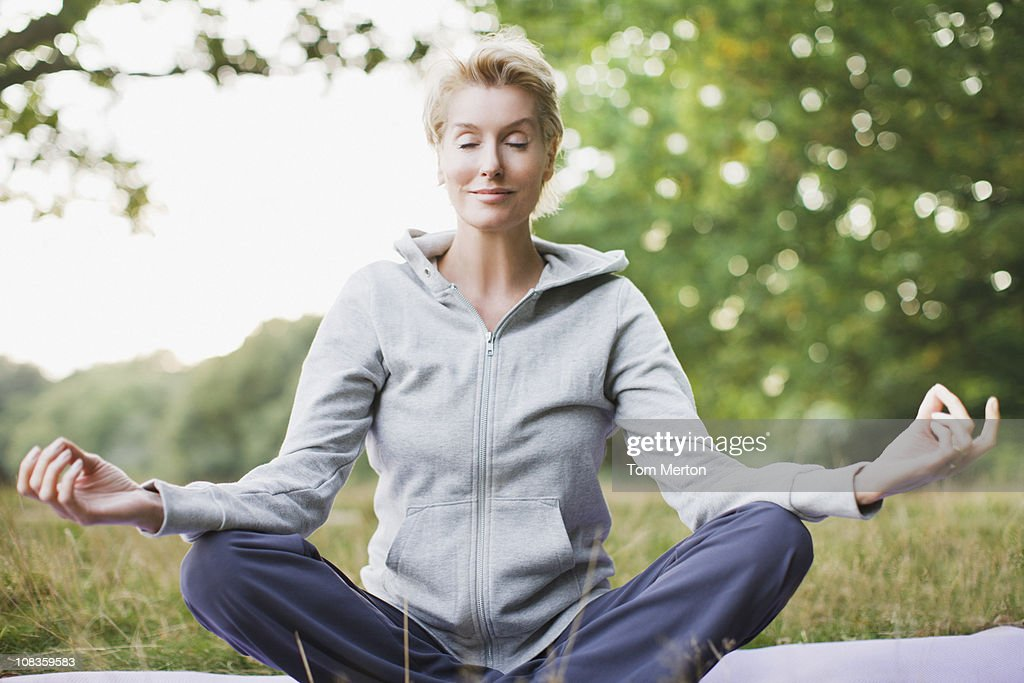Tranquil woman practicing yoga : Stock Photo