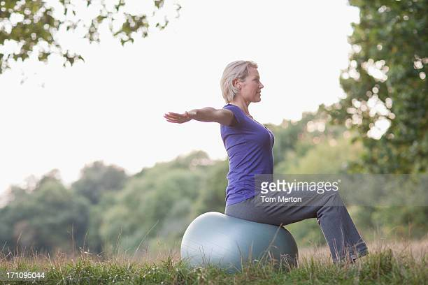tranquil woman practicing yoga - fitness ball stock pictures, royalty-free photos & images