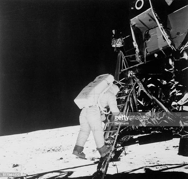 Astronaut Buzz Aldrin descends steps of the Lunar Module ladder as he prepares to walk on the Moon He had just egressed the LM Picture was made by...