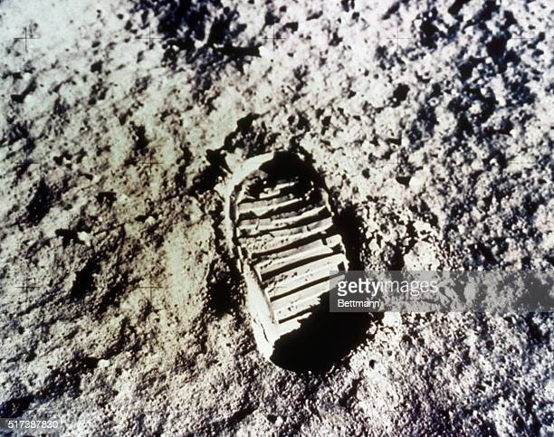 Tranquility Base The Moon This photo made July 21st from the Lunar Module shows in fine detail the impression made in the lunar soil by Apollo 11...