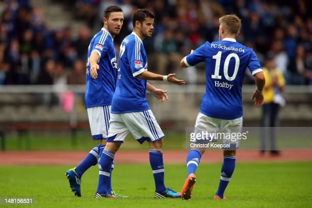 Tranquillo Barnetta celebrates the first goal with Marco Hoeger and Lewis Holtby of Schalke during the friendly match between ERGO national team and...