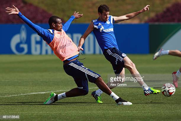 Tranquillo Barnetta is challenged by Felipe Santana during day 7 of the FC Schalke 04 training camp at the ASPIRE Academy for Sports Excellence on...