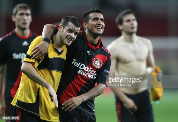 Tranquillo Barnetta of Leverkusen and Arturo Vidal celebrate the 1-0 victory after the UEFA Europa League Group B match between Bayer Leverkusen and...