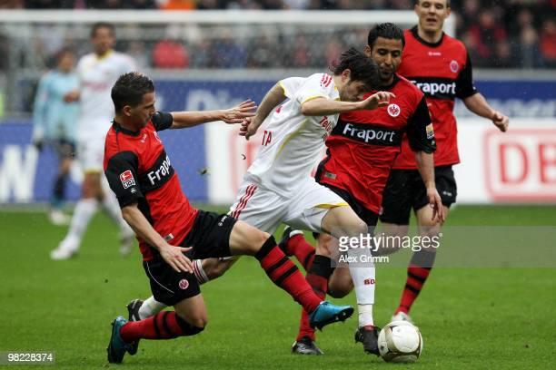 Tranquillo Barnetta of Leverkusen is challenged by Benjamin Koehler and Selim Teber of Frankfurt during the Bundesliga match between Eintracht...